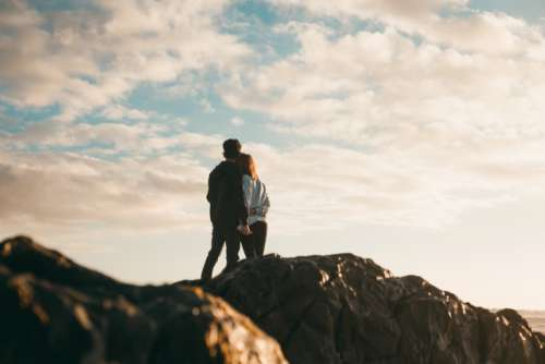 Couple standing on rocks at beach