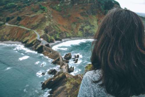 Woman wandering in a remote place. Wanderlust. Dragonstone.