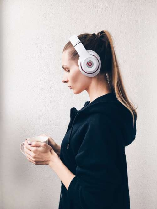 Girl is listening to music in headphones