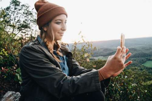 Girl using a mobile device in Fall