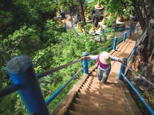 Climbing up Tiger Temple. Krabi, Thailand