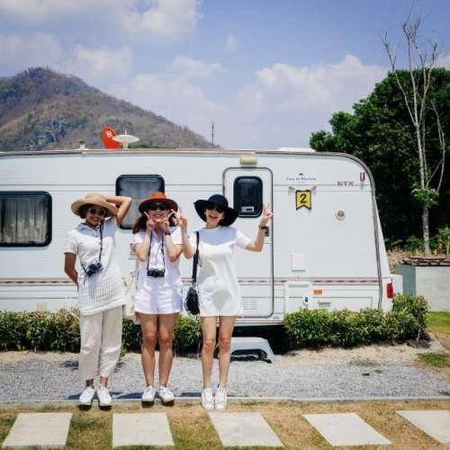 Girls in line in front of camper van