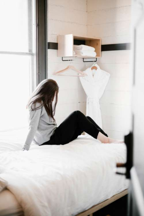 Girl in a modern, boutique hotel room
