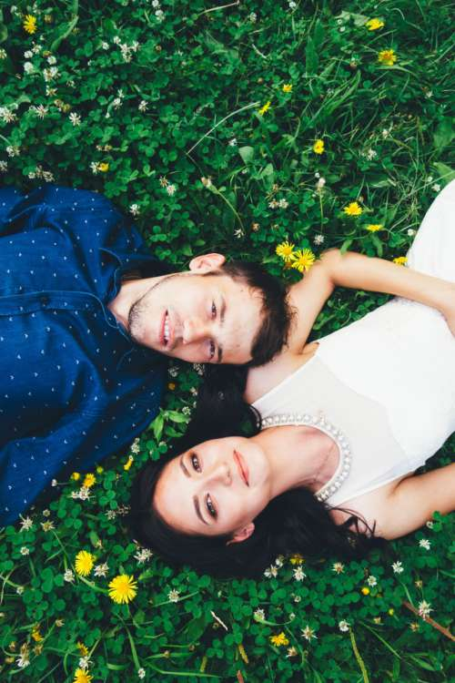 Couple lying on the juicy green grass