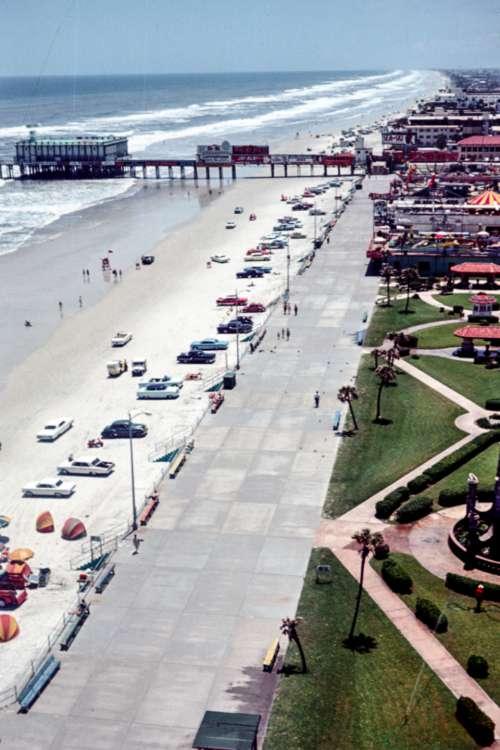 beach cars coast pier crowd