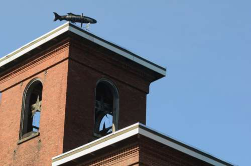 brick mill building tower weathervane