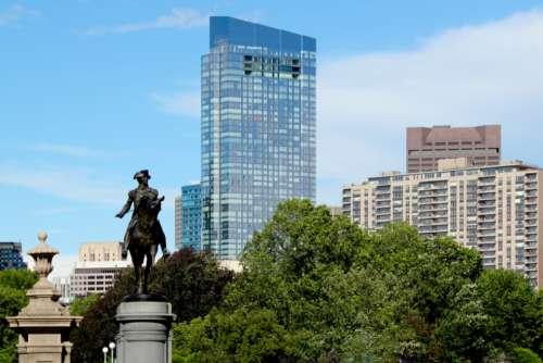 city statue park skyline glass
