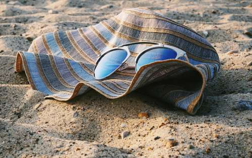 beach hat sand sunglasses travel
