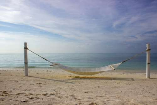 Hammock Placed Between Two Poles on a Beach