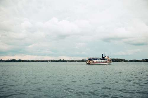 Ferry Crossing On Cloudy Day Photo