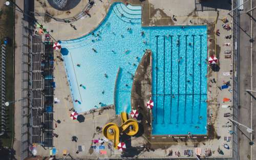 Aerial View Of Swimming Pool And Waterslides From Drone Photo