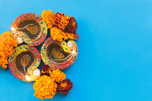 Diwali Diya On Blue Photo