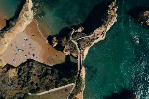 Bridge To Off Shore Rock Photo