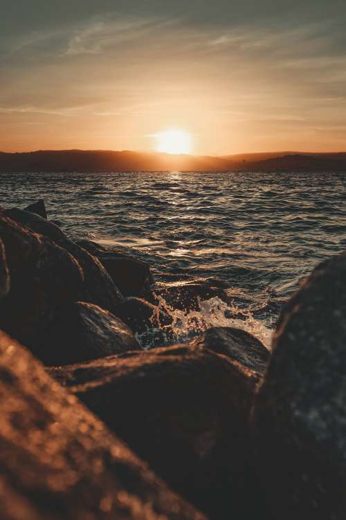 Rocky Seashore Sunset Photo