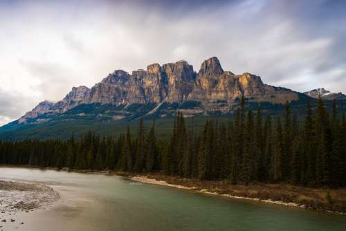 Castle Mountain Towering Over Lush Alberta Forest Photo