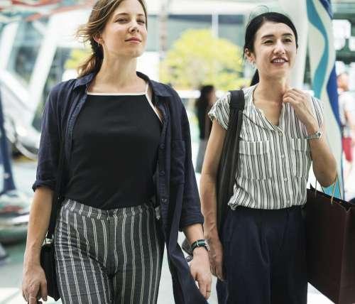 Two young women walking and shopping