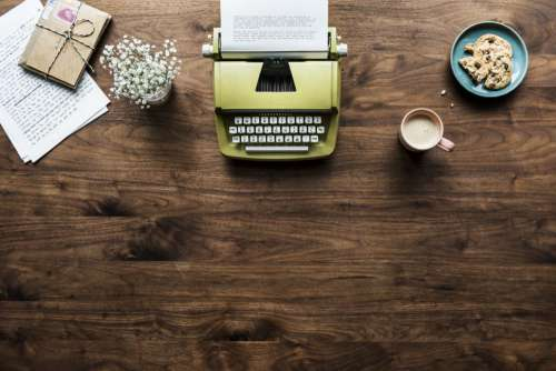 Overhead background of a vintage typewriter and desk items