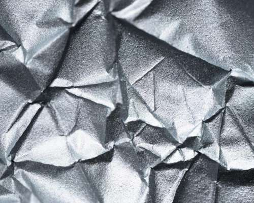 Abstract texture of sliver wrinkled paper