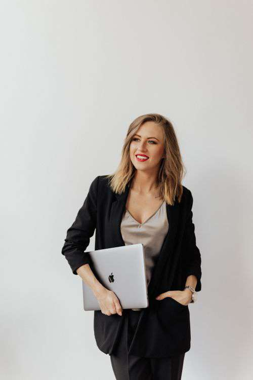 Pretty business woman with a laptop