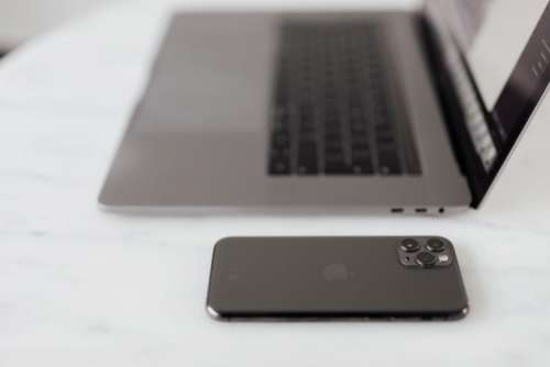 MacBook Pro 15 laptop and iPhone 11 Pro on a marble table
