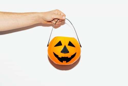 Male Hand Held Halloween Pumpkin
