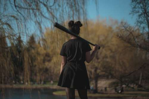 Woman with Baseball Bat Free Photo