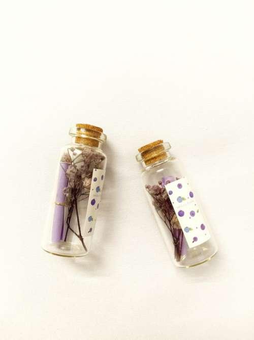 Glass Bottle Ornaments Flatlay Purple Decor