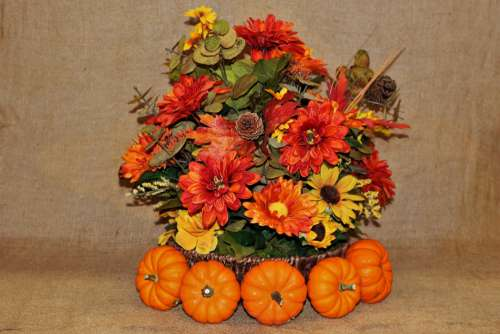 Pumpkins And Fall Flowers On Burlap
