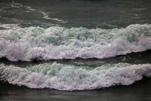 White Foamy Wave Rushing To Shore