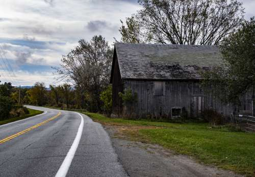 Gray Barn And Country Highway
