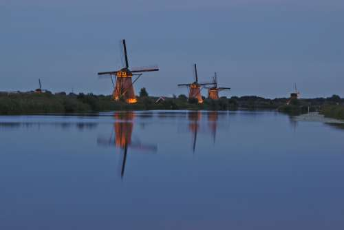 windmills mills evening lighting windmill