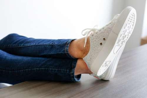 feet desk table office sneakers