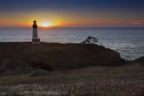 lighthouse landscape sunset ocean sea
