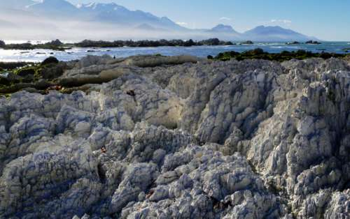 rocky coastline landscape mountains ocean