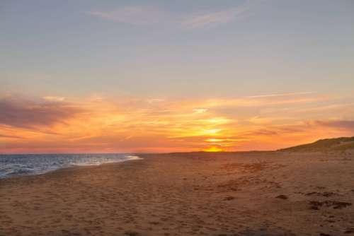 beach sunset sunrise sand ocean