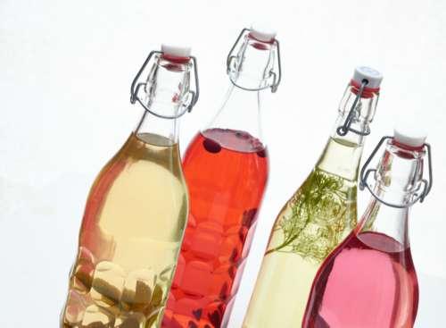 colored bottles spirits vodka herbs