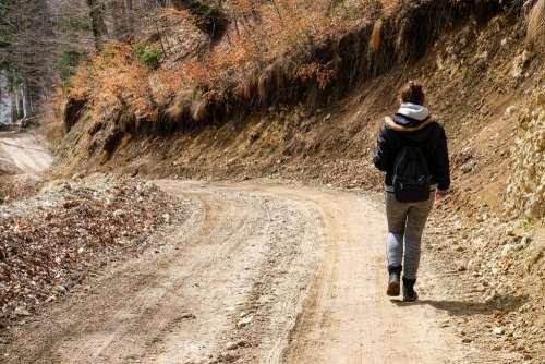 Girl Walking on a Mountain Path