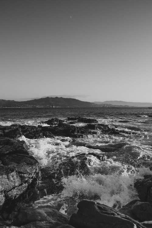 Black And White Waves On Rocks Photo