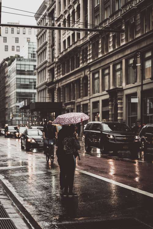 Standing In The Rain In The City Photo