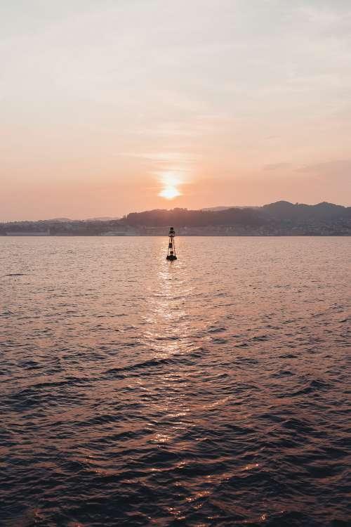 Buoy At Sunset Photo