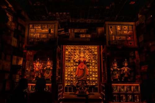 A Hindu Deity In A Dimly Lit Temple Photo