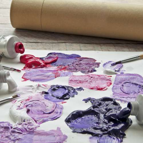 Blobs Of Purple, Red And White Paint Mixed Together On Paper Photo
