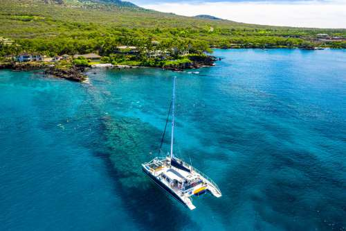 Overhead View Of Sailboat Anchored On Coral Reef Photo