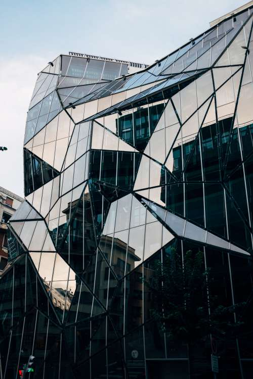 The Geometric Jutting Shapes Of A Mirrored Urban Facade Photo