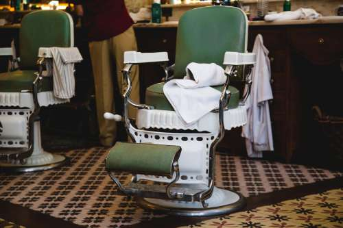 Pair Of Green And White Chairs In Barbershop Photo