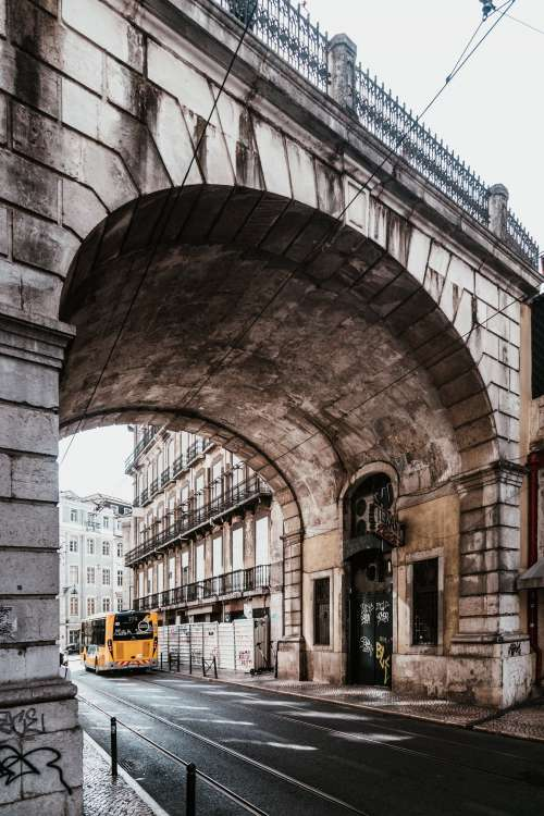 High Arching Bridge Over Lisbon City Street Photo