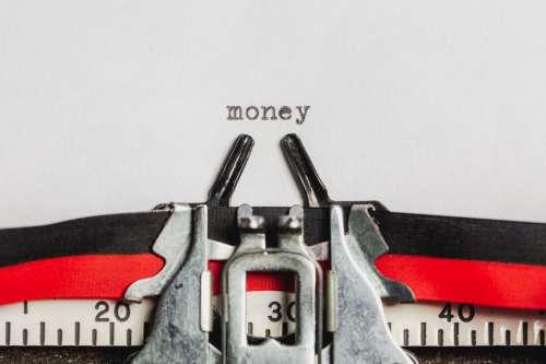 Money On A Typewriter Machine Photo
