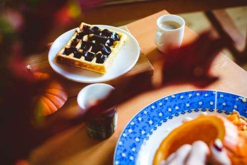 Homemade pumpkin waffle with dark chocolate topping