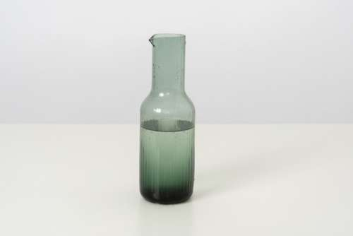 A Glass Bottle Of Cold Water, Designed In A Simple Style And Form