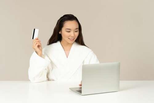 Smiling Young Asian Woman Doin Online Shopping
